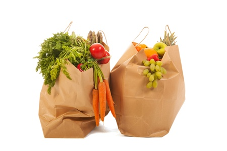 Heavy shopping bags full with vegetables and fruit photo