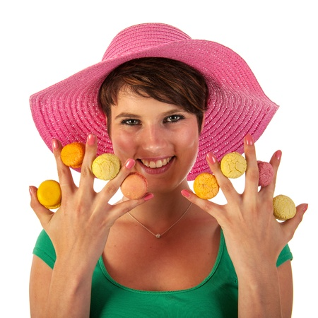 summer girl with fresh colorful macaroons photo