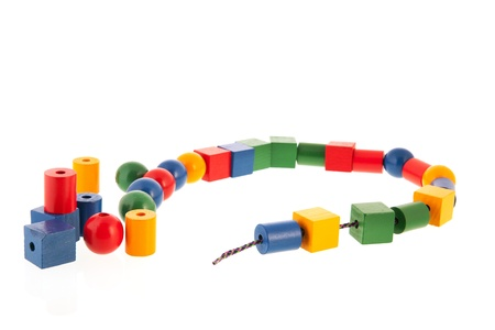 Wooden beads for toy chain photo