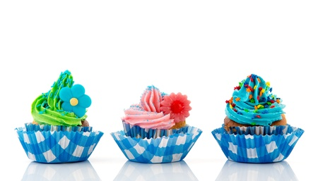 Row with three home made colorful cupcakes with butter cream photo