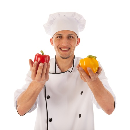 Cook with fresh paprikas choosing the right color isolated over white background photo