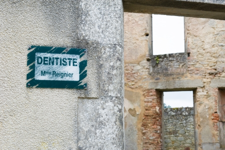 desecrated: Board of the dentist in Oradour sur Glane Stock Photo