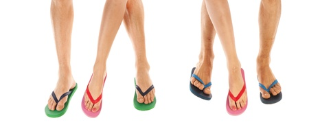 Many feet in colorful summer flip flops photo