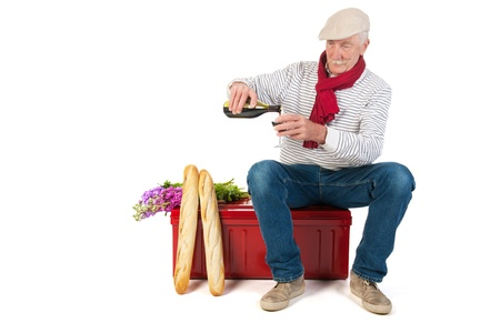Typical French man with bread and wine isolated over white background photo