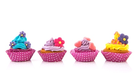 cupcakes in purple and pink with buttercream photo