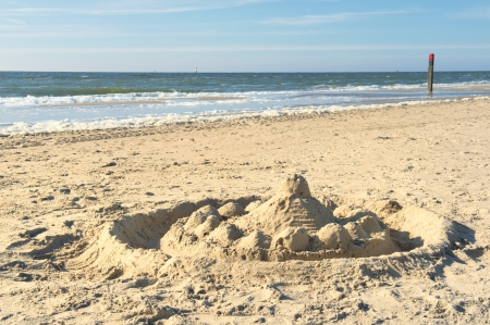 Sand castle at Northsea beach on Dutch wadden island Texel photo