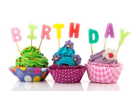 birthday cupcakes: Colorful birthday cupcakes with candles isolated over white background