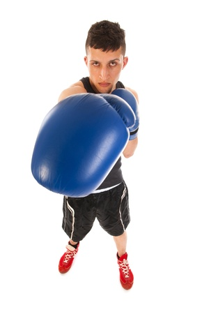 Boxing man with blue glovesis giving big punch photo