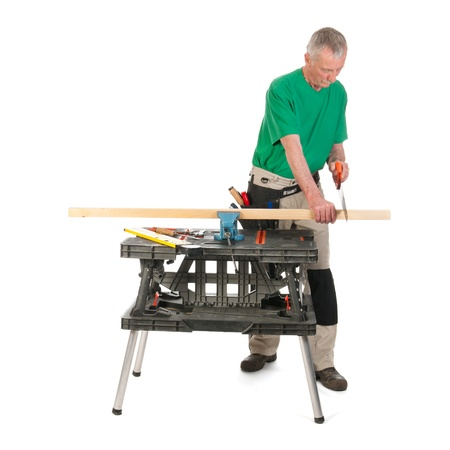 Senior construction worker is sawing a wooden shef Stock Photo - 21403226