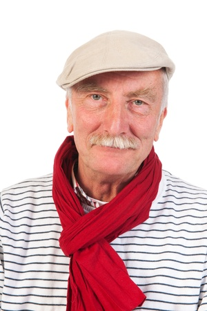 Portrait senior man with cap and scarf