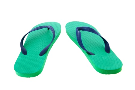 Green and blue flip flops isolated over white background photo