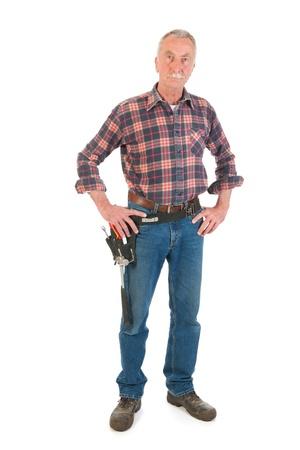 Senior man as manual worker standing in studio Stock Photo - 21403364