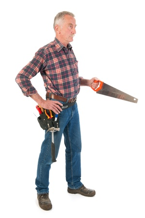 Senior man is working with saw Stock Photo - 21403365