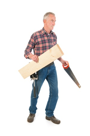 Senior manual worker with saw and timber Stock Photo - 21403366