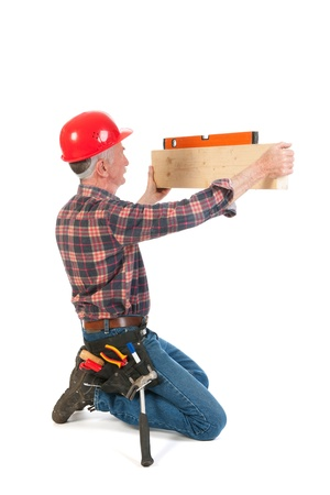 Senior man as manual worker with water rule Stock Photo - 21403368