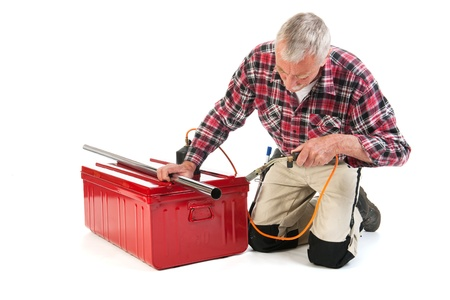 Senior man as manual worker solder metal isolated over white background Stock Photo - 21403369