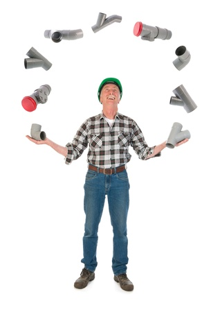 Funny plumber juggling with PVC tubes over white background photo