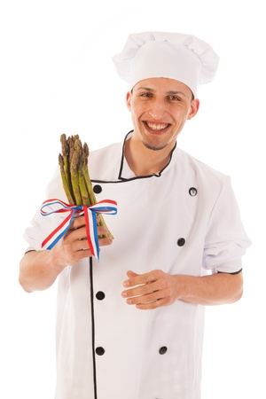 Dutch asparagus with ribbon in flag colors holding by cook photo