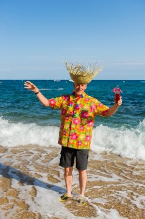 Senior man is having vacation at the beach photo