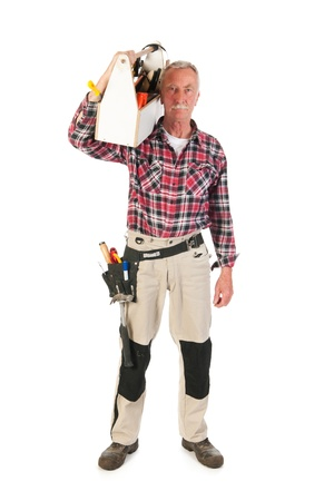 Senior man as manual worker carrying at heavy toolkit photo