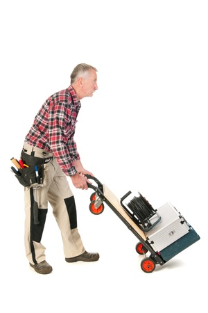 Senior man as manual worker driving his toolkit photo