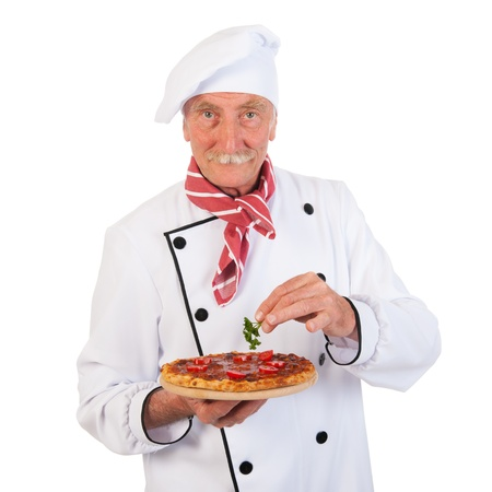 Italian cook holding pizza for finishing touch photo