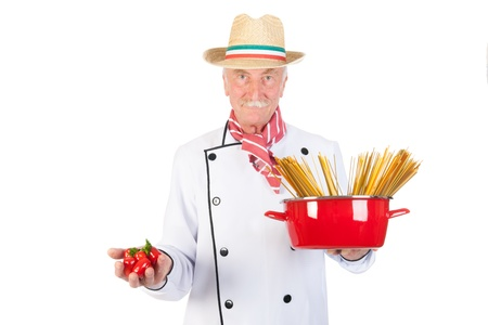 Italian cook with pan pasta and tomatoes photo