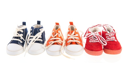 Baby sport shoes isolated over white background photo