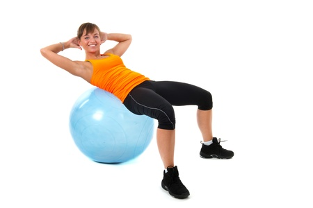Sport girl with blue gymnastic ball photo