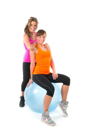 Two sport girls with blue gymnastic ball photo