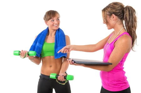 Young woman is training muscles by female personal trainer photo