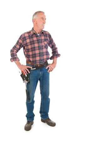 Senior man as manual worker standing in studio Stock Photo - 22115598