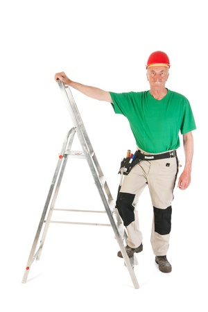 Senior man as manual worker with stepladder isolated over white background Stock Photo - 22115602