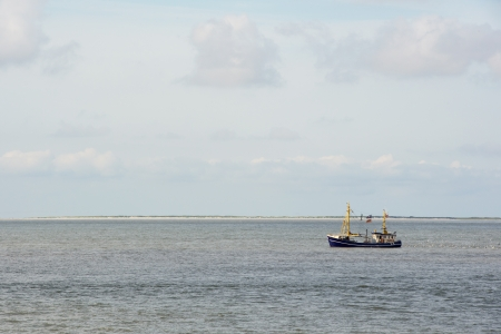 wadden: Blue fishing boat at the wadden sea Stock Photo