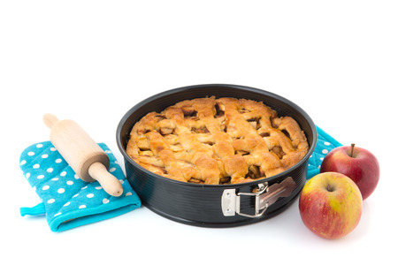 Baked apple pie with fresh fruit and kitchen utensils photo