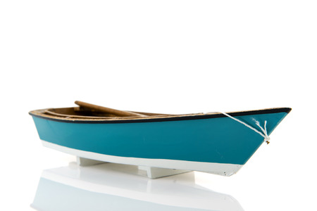 modell: Blue miniature rowing boat isolated over white background Stock Photo