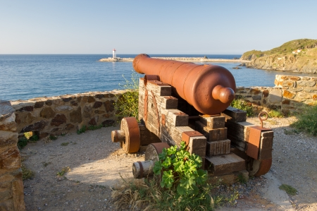 port vendres: Landscape with old canon in harbor of Port Vendres Stock Photo
