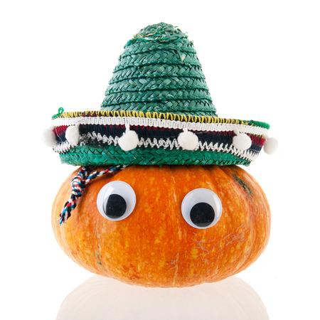 Spanish whole pumpkin with eyes isolated over white background photo