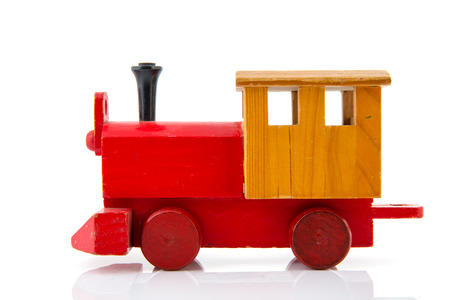 Red wooden toy locomotive isolated over white background photo