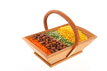 Assortment legumes in wooden basket photo