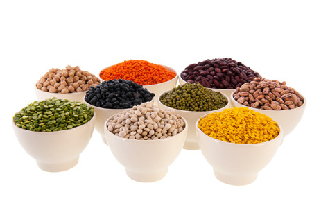 Assortment legumes in white bowls Stock Photo - 22821409