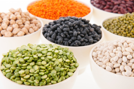 Assortment legumes in white bowls Stock Photo - 22821411