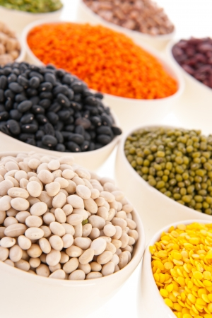Assortment legumes in white bowls Stock Photo - 22821412