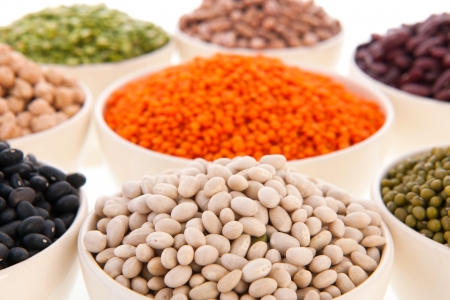 Assortment legumes in white bowls Stock Photo - 22821414