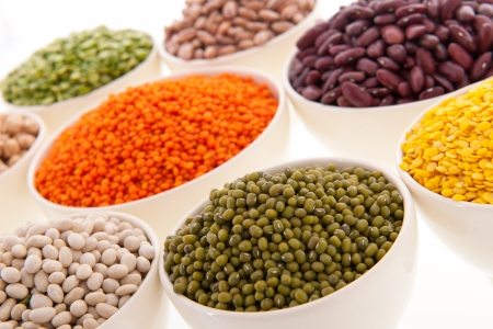 Assortment legumes in white bowls Stock Photo - 22821415