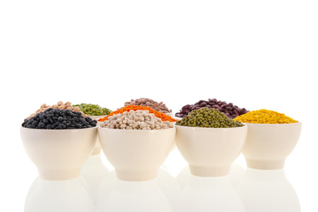 Assortment legumes in white bowls Stock Photo - 22821416