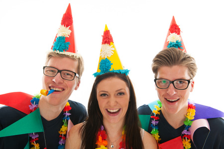 Identically adult male twins having birthday together with girl in studio photo