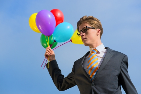 blowed: Business man outdoor with balloons Stock Photo