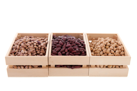 Assortment legumes in wooden crates photo