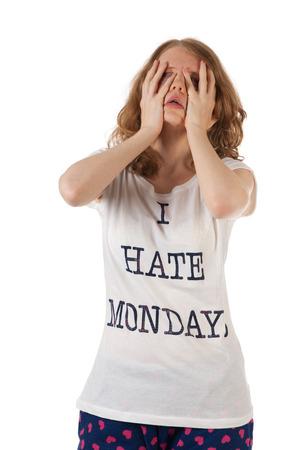 De jonge vrouw haat maandagen Stockfoto